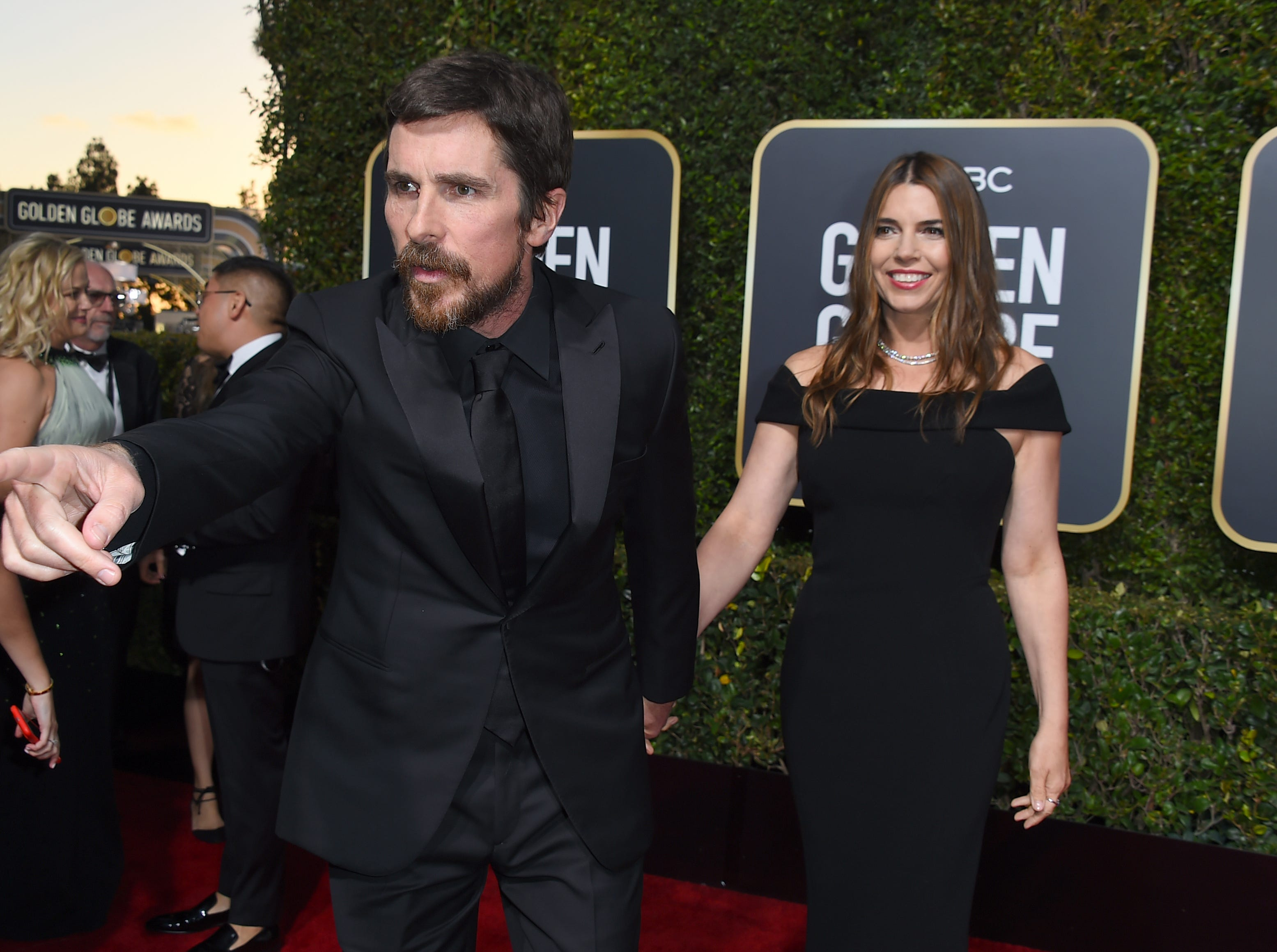 Christian Bale, left, gestures as he and Sibi Blazic arrive at the 76th annual Golden Globe Awards at the Beverly Hilton Hotel.