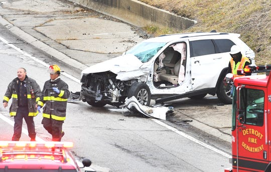 Firefighters work at the scene of multi-vehicle accident on I-94 near Brush in Detroit, Monday afternoon.