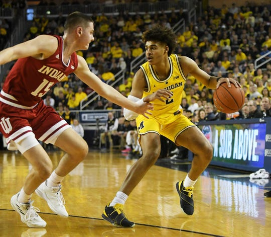 "Michigan guard Jordan Poole, right, has an offensive skill set that translates to the NBA, but he is far from a ""finished product,"" according to SI's Jeremy Woo."