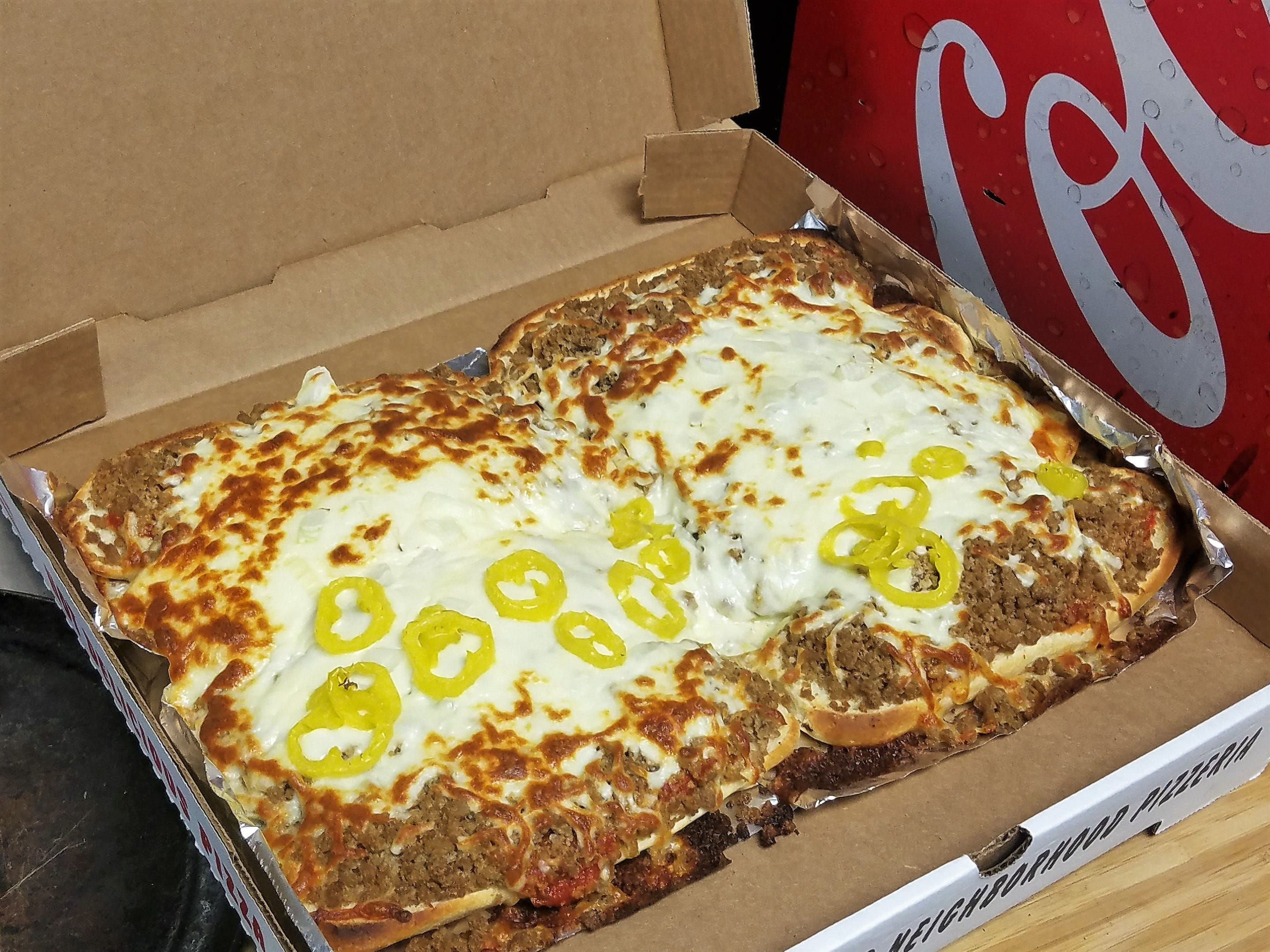 This is how Lobo Lounge bakes their 4 stromboli for $20 special.