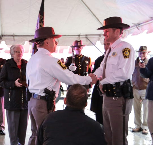Recently retired Fond du Lac County Sheriff Mick Fink shakes the hand of newly sworn in Sheriff Ryan Waldschmidt Monday, January 7, 2019 on Western Avenue in Fond du Lac, Wisconsin after Fink did the ceremonial retirement ramp walk and Waldschmidt was sworn in as sheriff. Fink retired from the position of Fond du Lac County Sheriff after serving for 12 years. Roxanne Abler/USA TODAY NETWORK-Wisconsin