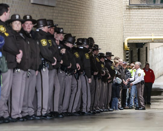 Fond du Lac County Sheriff Mick Fink shakes the hands of Fond du Lac County Sheriff's office deputies as he does the ceremonial retirement ramp walk Monday, January, 7, 2019 at the sheriff's office building in Fond du Lac. Fink retired from the position of Fond du Lac County Sheriff after serving for 12 years.