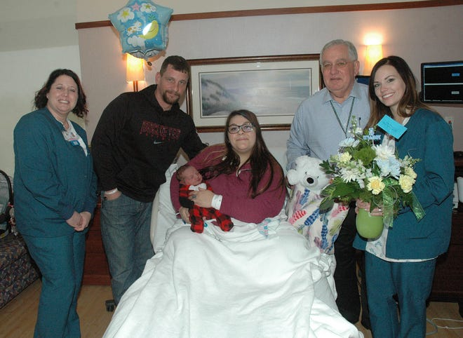 Members of The Bellevue Hospital congratulate Carter Douglas Estep, was the hospital's first baby born in 2019. From left are Kristy Lozano, registered nurse; Gary Estep, father; Brittany Cooper, mother; Michael K. Winthrop, President and CEO of TBH; and Rachel Figgins, registered nurse.