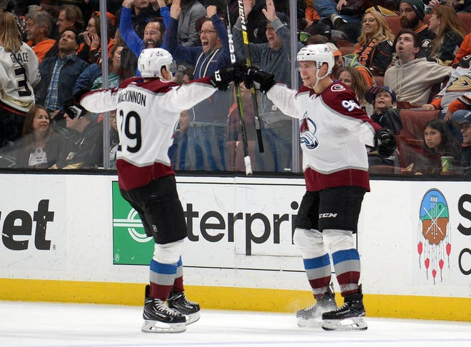 November 18, 2018; Anaheim, CA, USA; Colorado Avalanche right wing Mikko Rantanen (96) celebrates with center Nathan MacKinnon (29) his game winning goal scored against the Anaheim Ducks during the overtime period at Honda Center. MacKinnon provided an assist on the goal. Mandatory Credit: Gary A. Vasquez-USA TODAY Sports