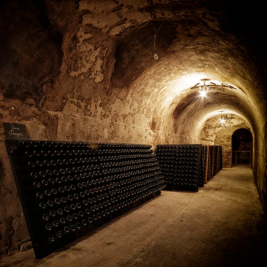 Bottles of Palmer & Co. Champagne age in French caves.
