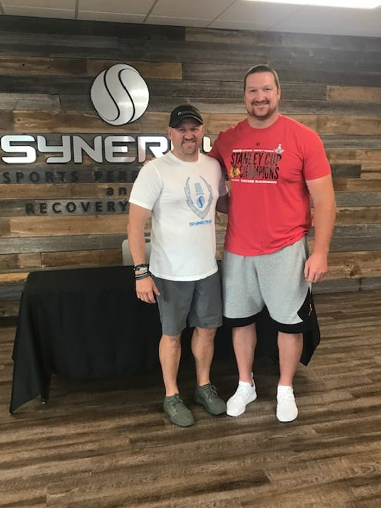 Scotty Smith, owner of Synergy Sports Performance, has added a 3,000-square-foot sports recovery center that is designed to help athletes recover faster from intense workouts. He is shown with Packers offensive lineman Bryan Bulaga.