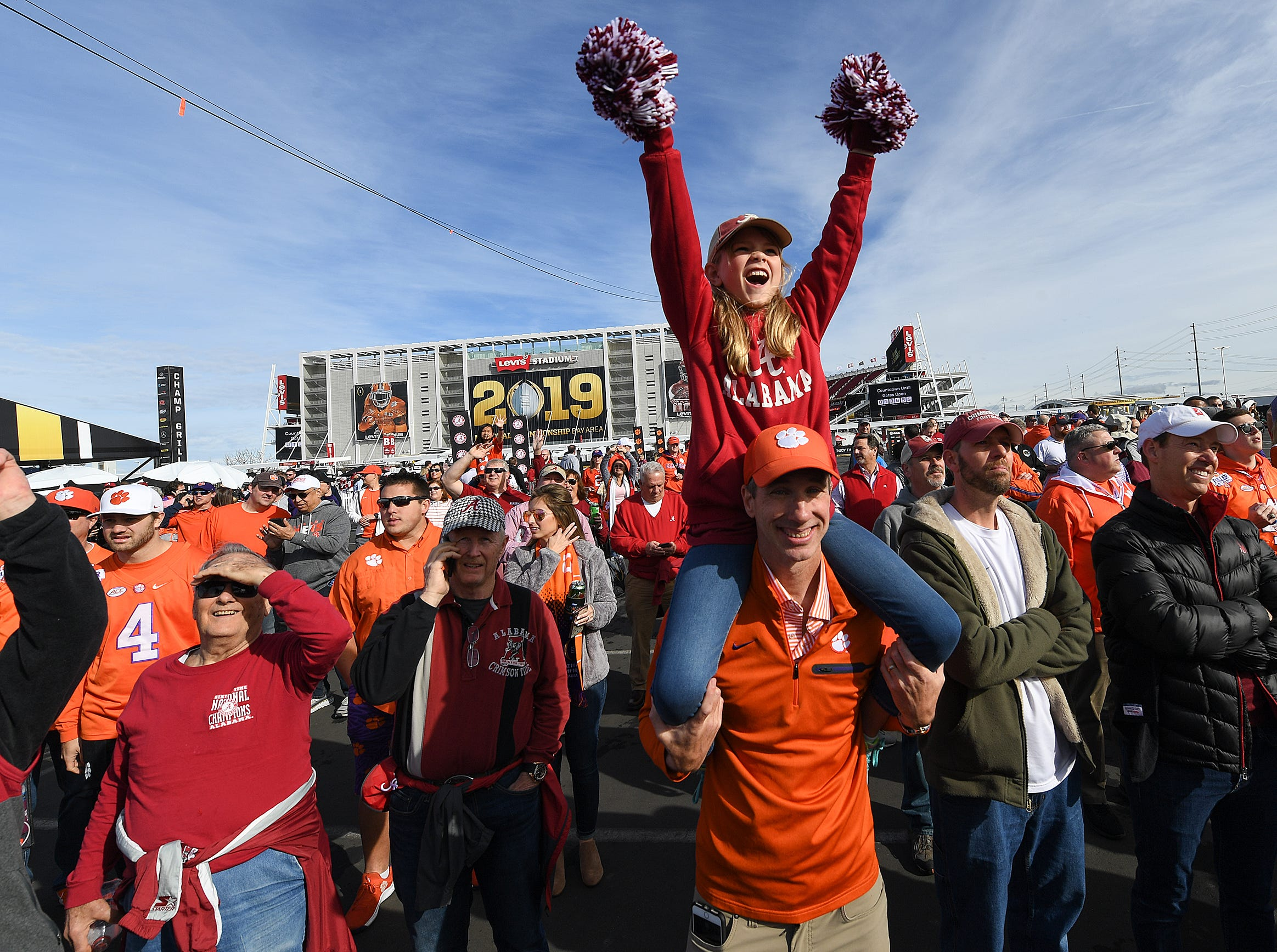 Hadley Miller sits on her father Russ's shoulders during the College Football Championship Playoff Tailgate outside Levi's Stadium in Santa Clara, CA Monday, January 7, 2019. The pair are from Greenville.