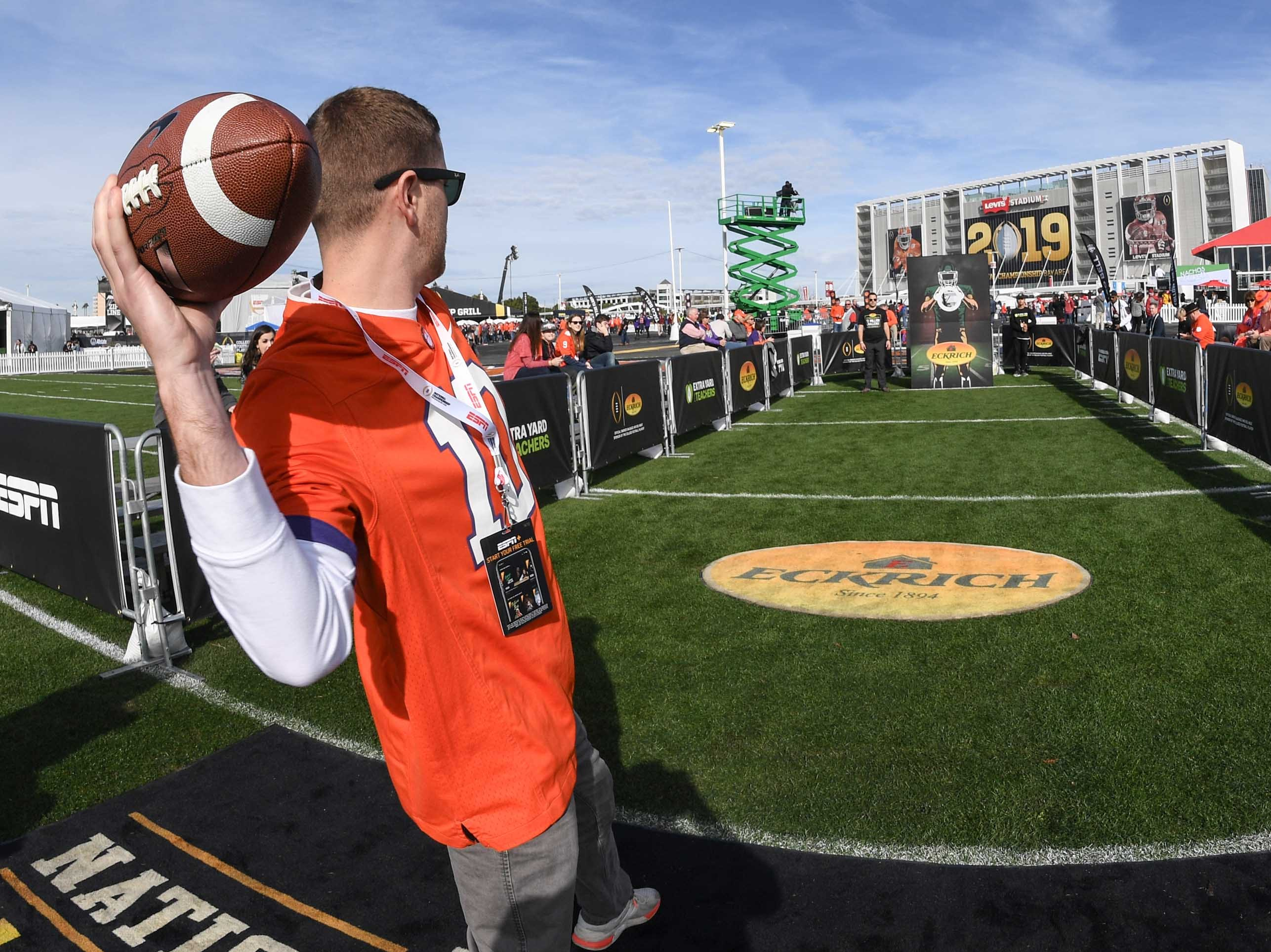 Clemson fan Kyle Clifford of Atlanta tosses a football at the College Football Championship Playoff Tailgate outside Levi's Stadium in Santa Clara, California Monday, January 7, 2019.