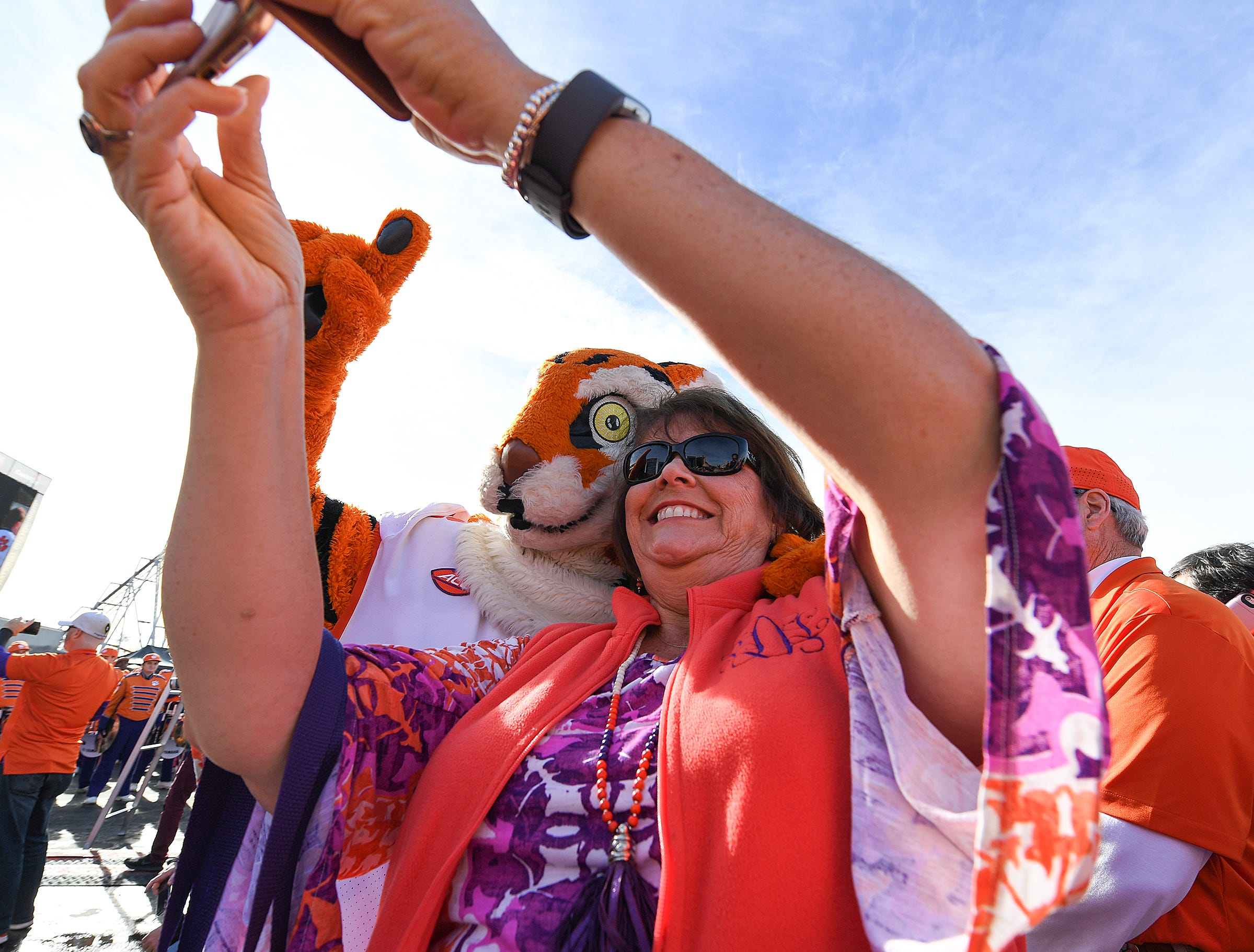 A Clemson fans poses for a selfie with the Tiger during the College Football Championship Playoff Tailgate outside Levi's Stadium in Santa Clara, CA Monday, January 7, 2019.
