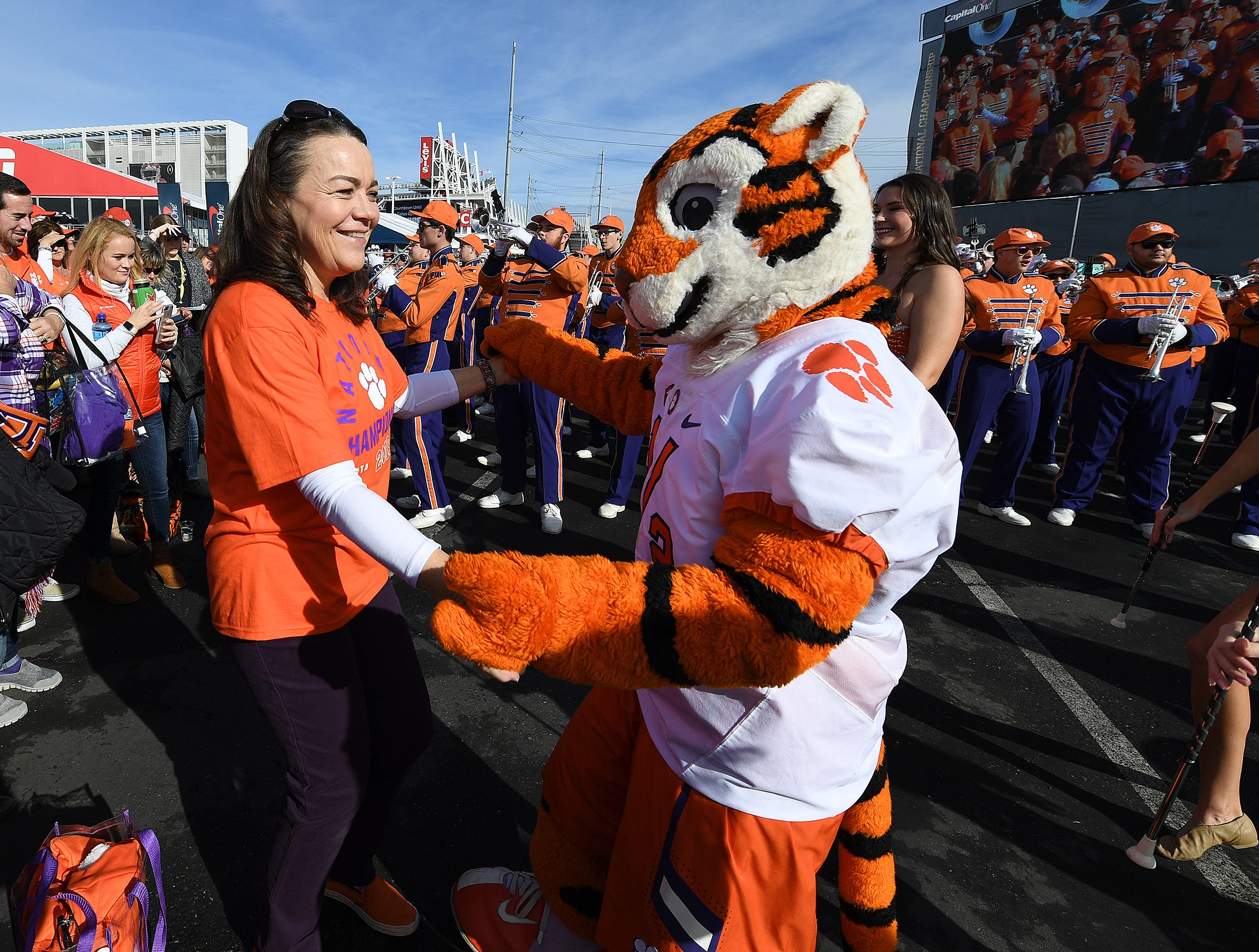 The Tiger Cub dances with a fan during the College Football Championship Playoff Tailgate outside Levi's Stadium in Santa Clara, CA Monday, January 7, 2019.