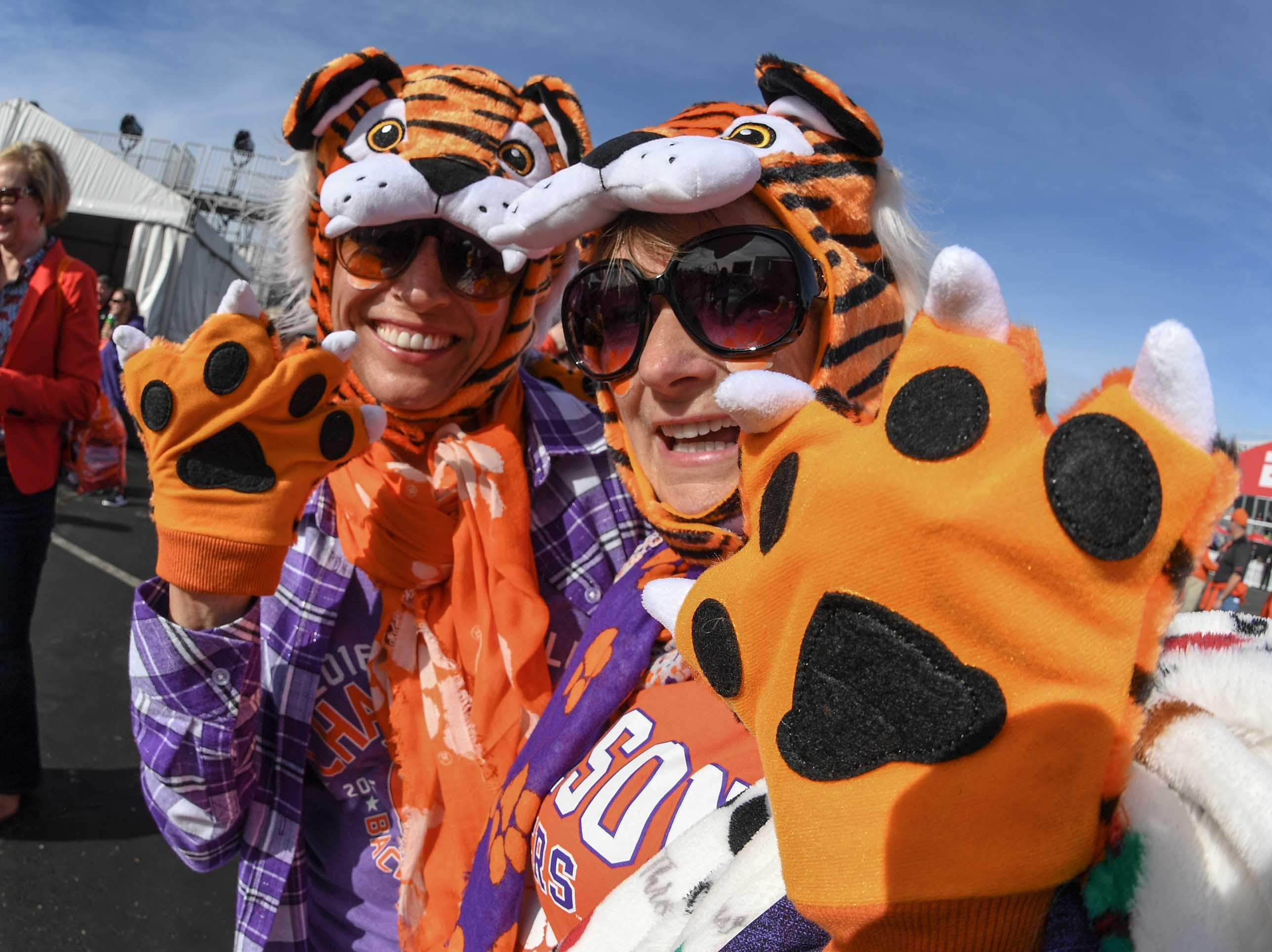 Clemson fans Christine Faenza, left, and Deborah Nelson participate at the College Football Championship Playoff Tailgate outside Levi's Stadium in Santa Clara, California Monday, January 7, 2019.