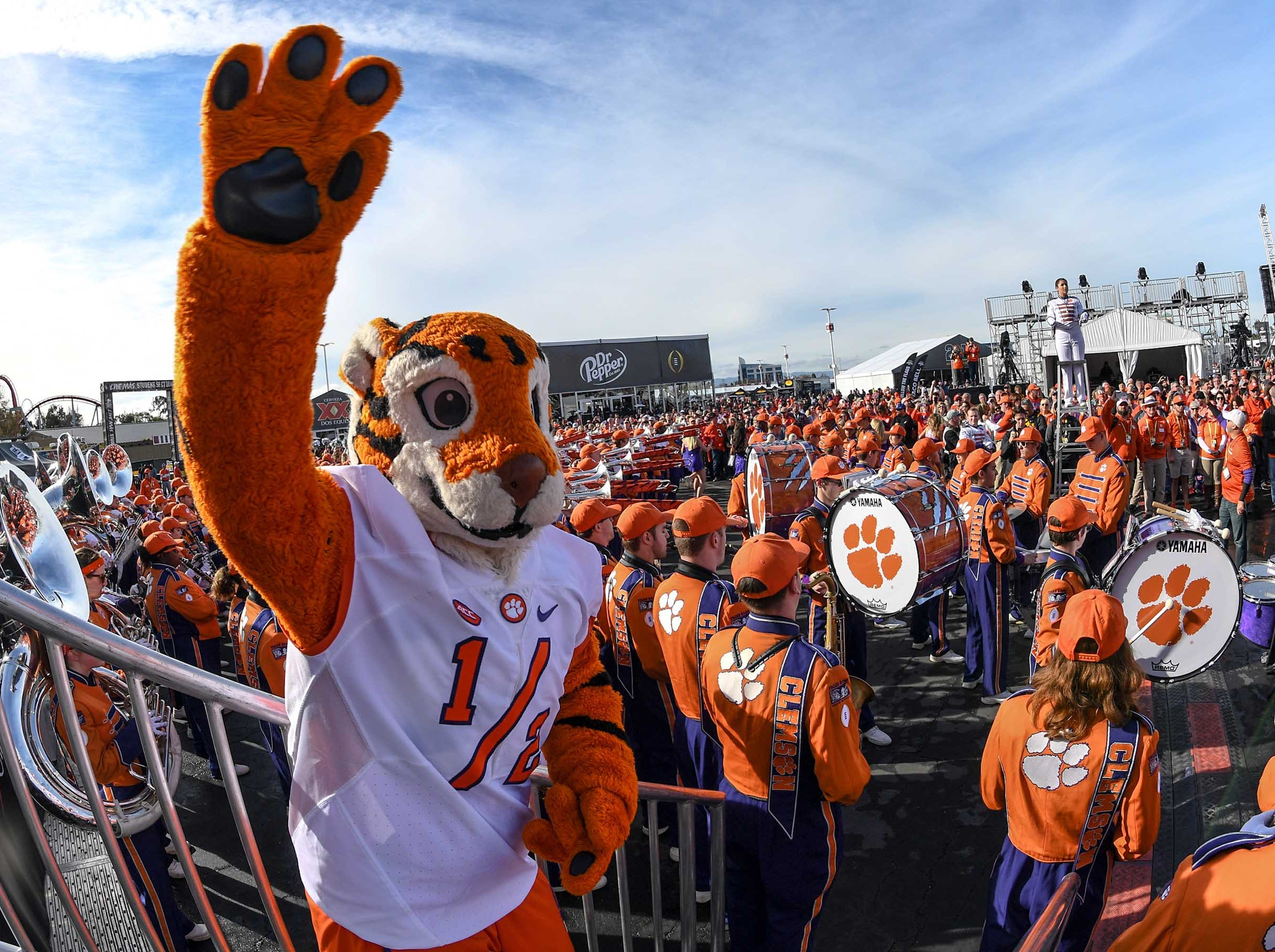 Clemson Tiger Cub waves standing with the Tiger Band, cheerleaders, Tiger Dancers, twirlers, and Rally Cats participate with fans at the College Football Championship Playoff Tailgate outside Levi's Stadium in Santa Clara, California Monday, January 7, 2019.