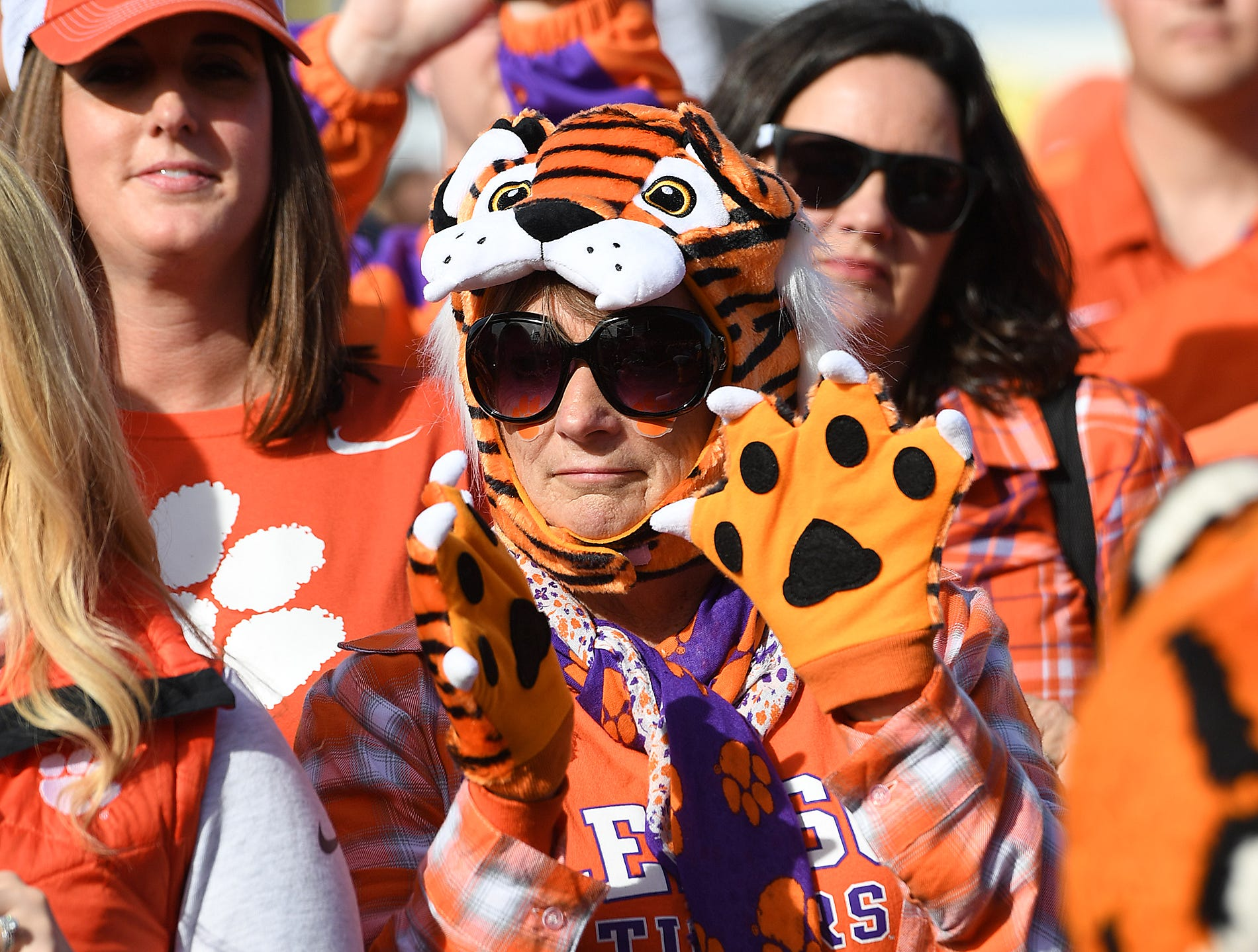 Duchess Sicay cheer for the Clemson band during the College Football Championship Playoff Tailgate outside Levi's Stadium in Santa Clara, CA Monday, January 7, 2019.