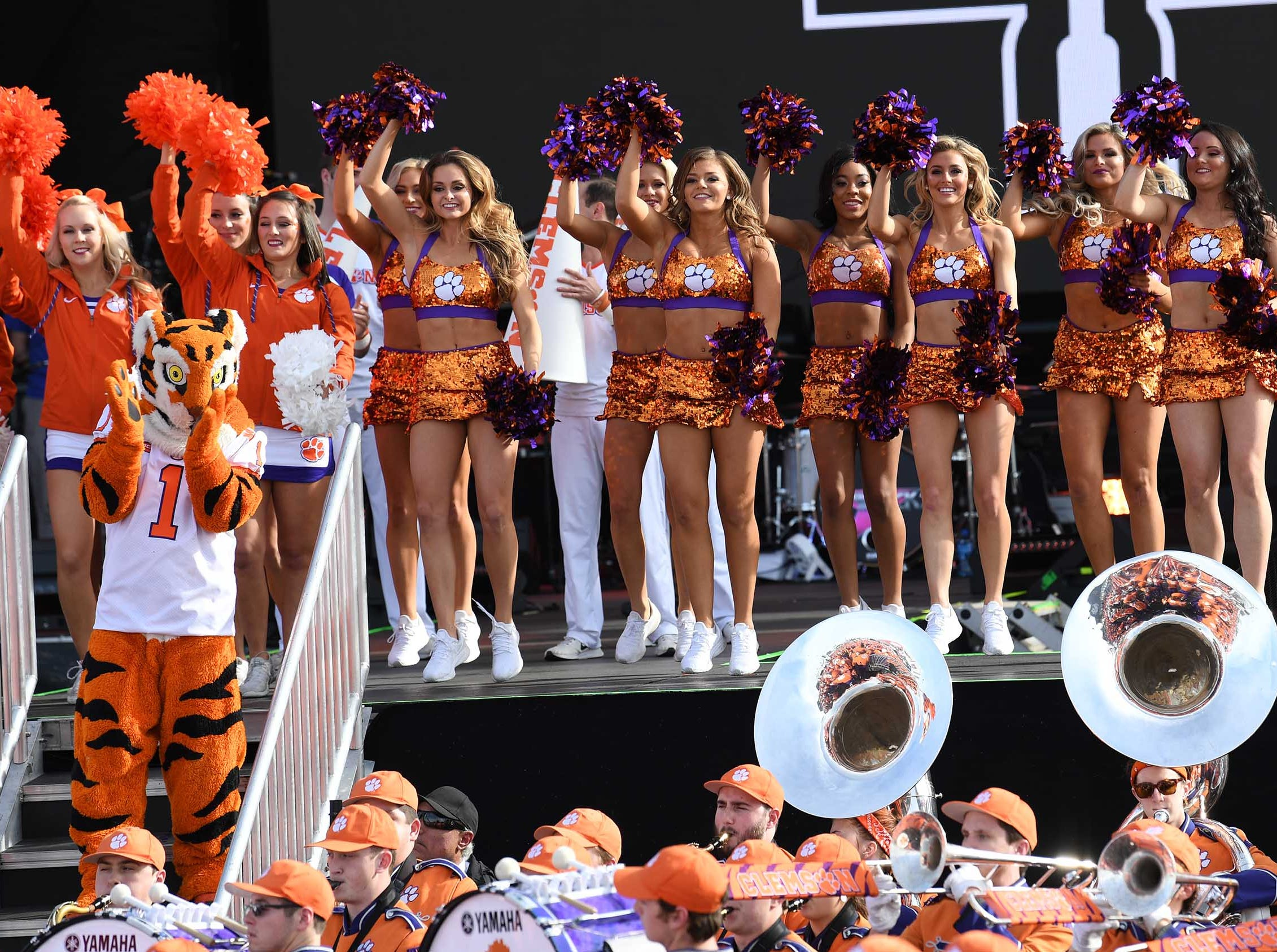 Clemson Tiger Band, cheerleaders, Tiger Dancers, twirlers, and Rally Cats participate with fans at the College Football Championship Playoff Tailgate outside Levi's Stadium in Santa Clara, California Monday, January 7, 2019.