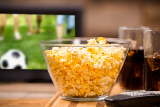 Pop some popcorn and let the kids choose toppings for your at-home movie party.