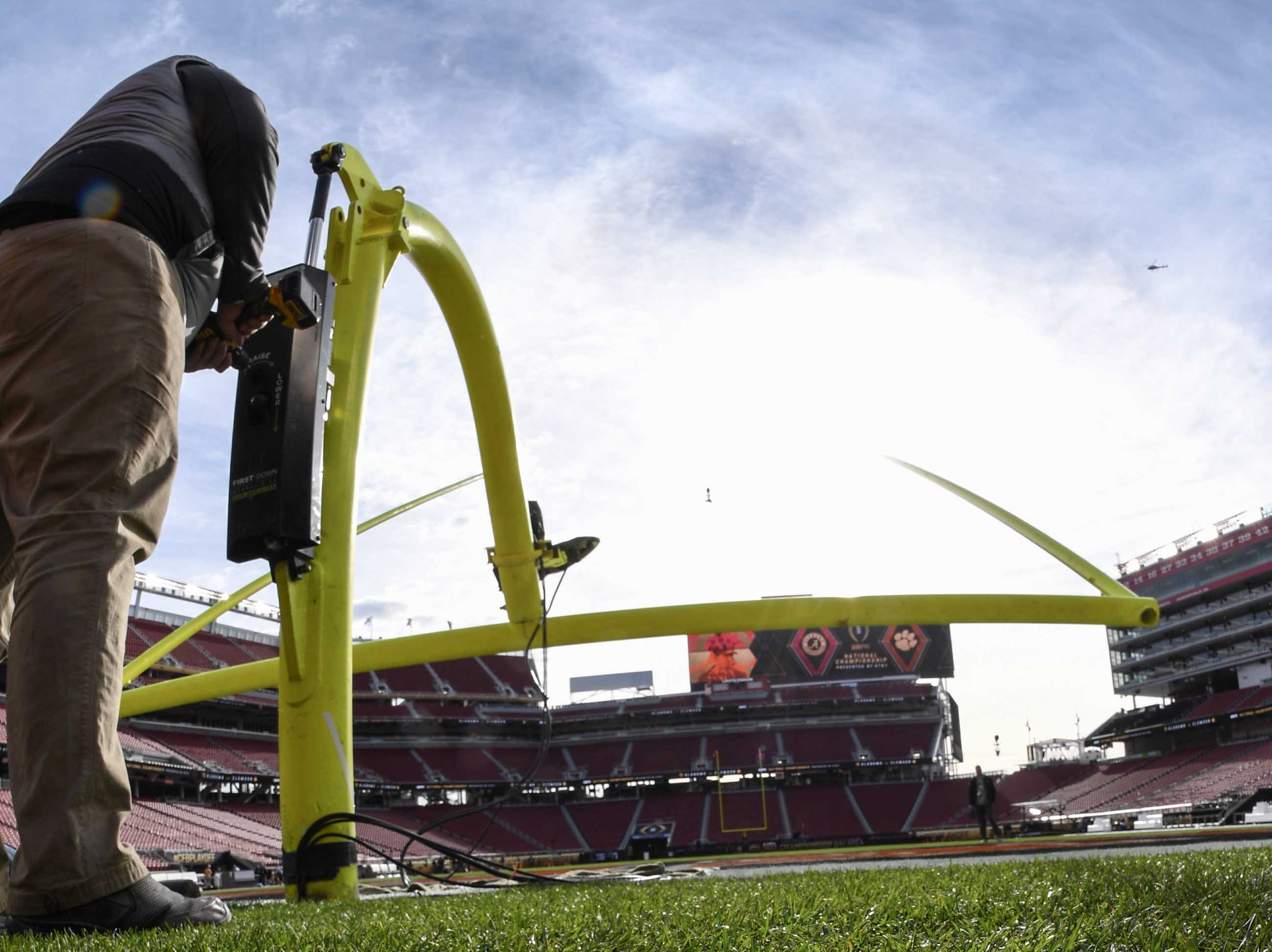 Goal posts are raised near dry grass, which was covered during recent rain, before the kickoff during the College Football Championship at Levi's Stadium in Santa Clara, California Monday, January 7, 2019.