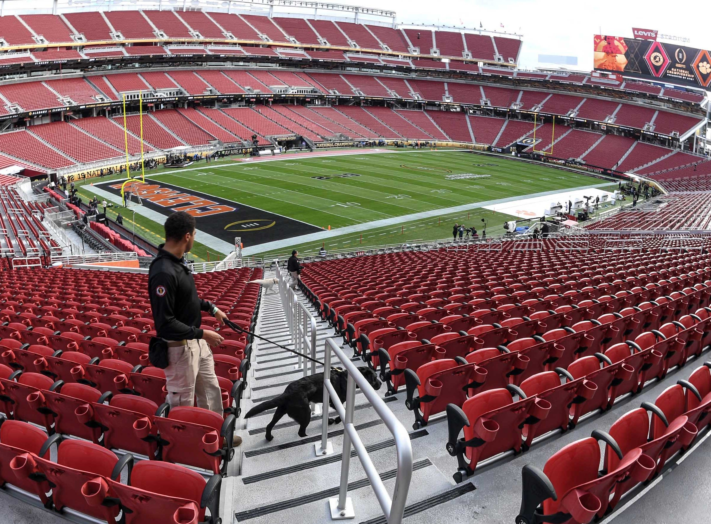 Officials patrol the stadium as many prepare before the kickoff during the College Football Championship at Levi's Stadium in Santa Clara, California Monday, January 7, 2019.