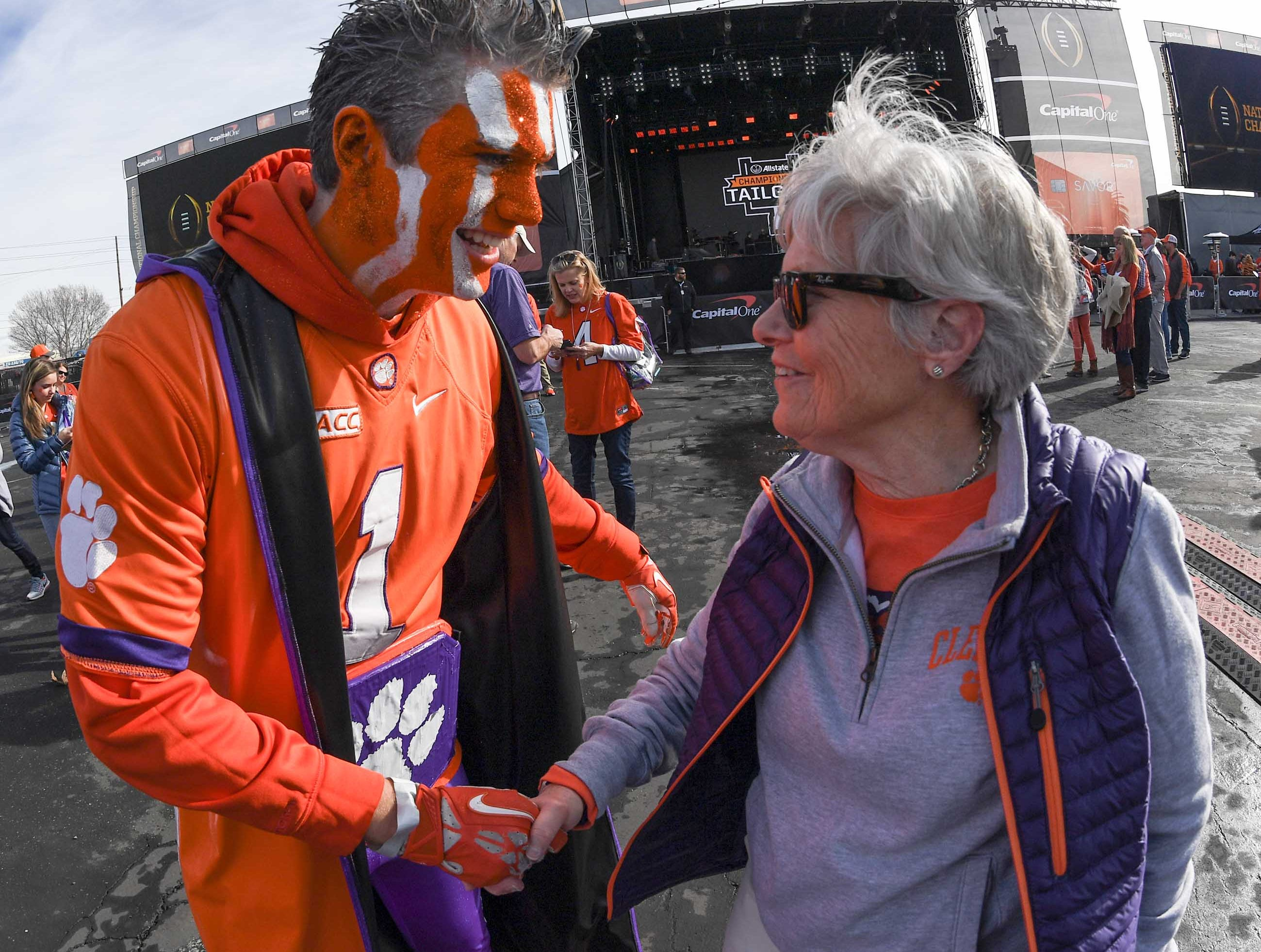 Clemson fan Peter Rowan, left, calling himself MVPeter, meets Betty Bagley at the College Football Championship Playoff Tailgate outside Levi's Stadium in Santa Clara, California Monday, January 7, 2019.