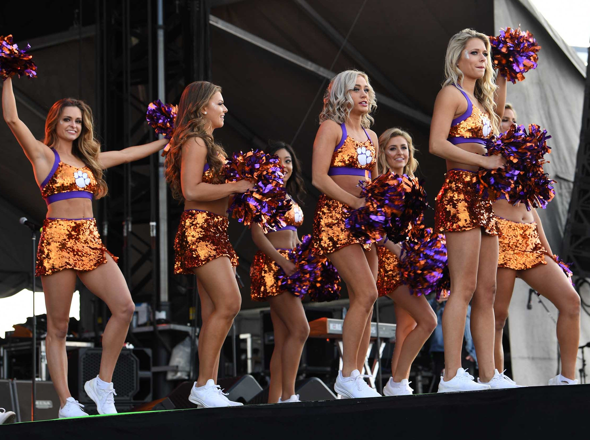 Clemson Rally Cats preform with Tiger Band, cheerleaders, Tiger Dancers, twirlers, and fans at the College Football Championship Playoff Tailgate outside Levi's Stadium in Santa Clara, California Monday, January 7, 2019.