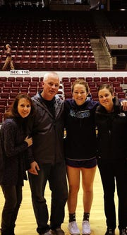 Molly Schmitz poses with her parents and sister Michela in Missoula before taking on the Lady Griz.