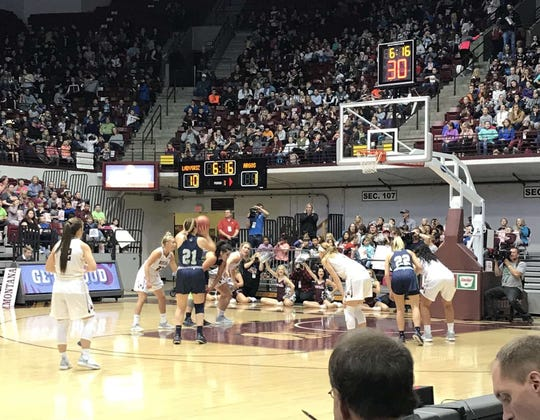 Molly Schmitz (#21) shoots a free throw in an exhibition game in Missoula against the University of Montana.
