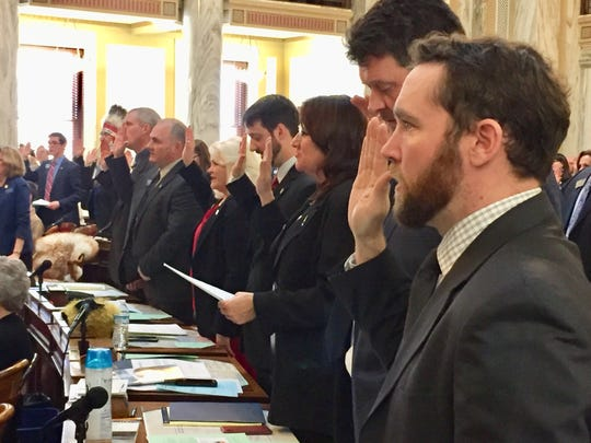 Lawmakers take the oath of office Monday in Helena.