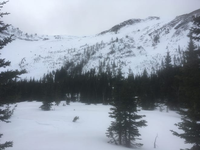 This is the location of a Saturday avalanche that claimed the life of a Choteau man. Two riders were overtaken by snow below the ridge on the left side of the photo.