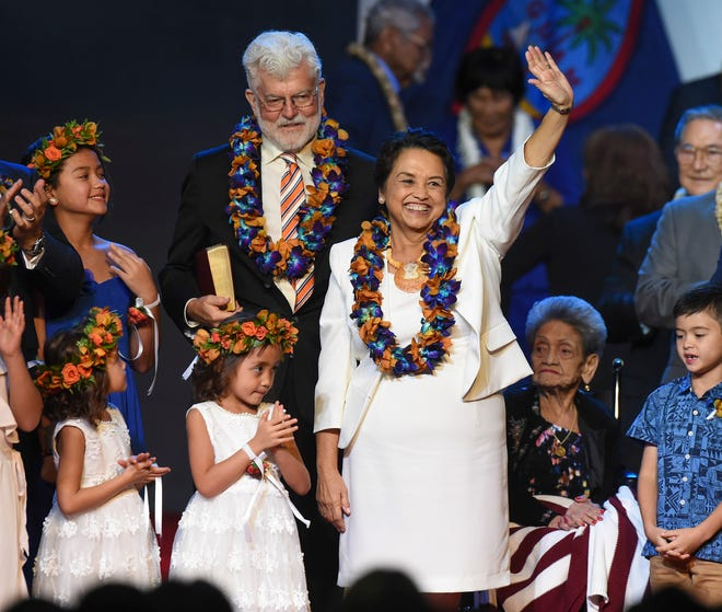Gov. Lou Leon Guerrero waves to the crowd during the 13th Gubernatorial Inauguration at the University of Guam Calvo Field House, Jan. 7, 2019.