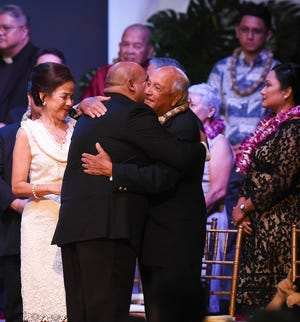 Gov.-elect Josh Tenorio, left, greets former governor of Guam, Carl T.C. Gutierrez during the 13th Gubernatorial Inauguration at the University of Guam Calvo Field House, Jan. 7, 2019.