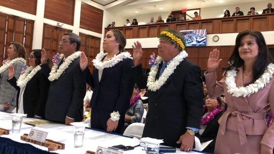 Senators, from left, Kelly Marsh, Sabina Perez, Joe San Agustin , Amanda Shelton, Jose Terlaje, and Therese Terlaje take their oath of office on Jan. 7, 2019. The 15-member 35th Guam Legislature has 10 female senators, and Democrats hold a super majority with 10 members.