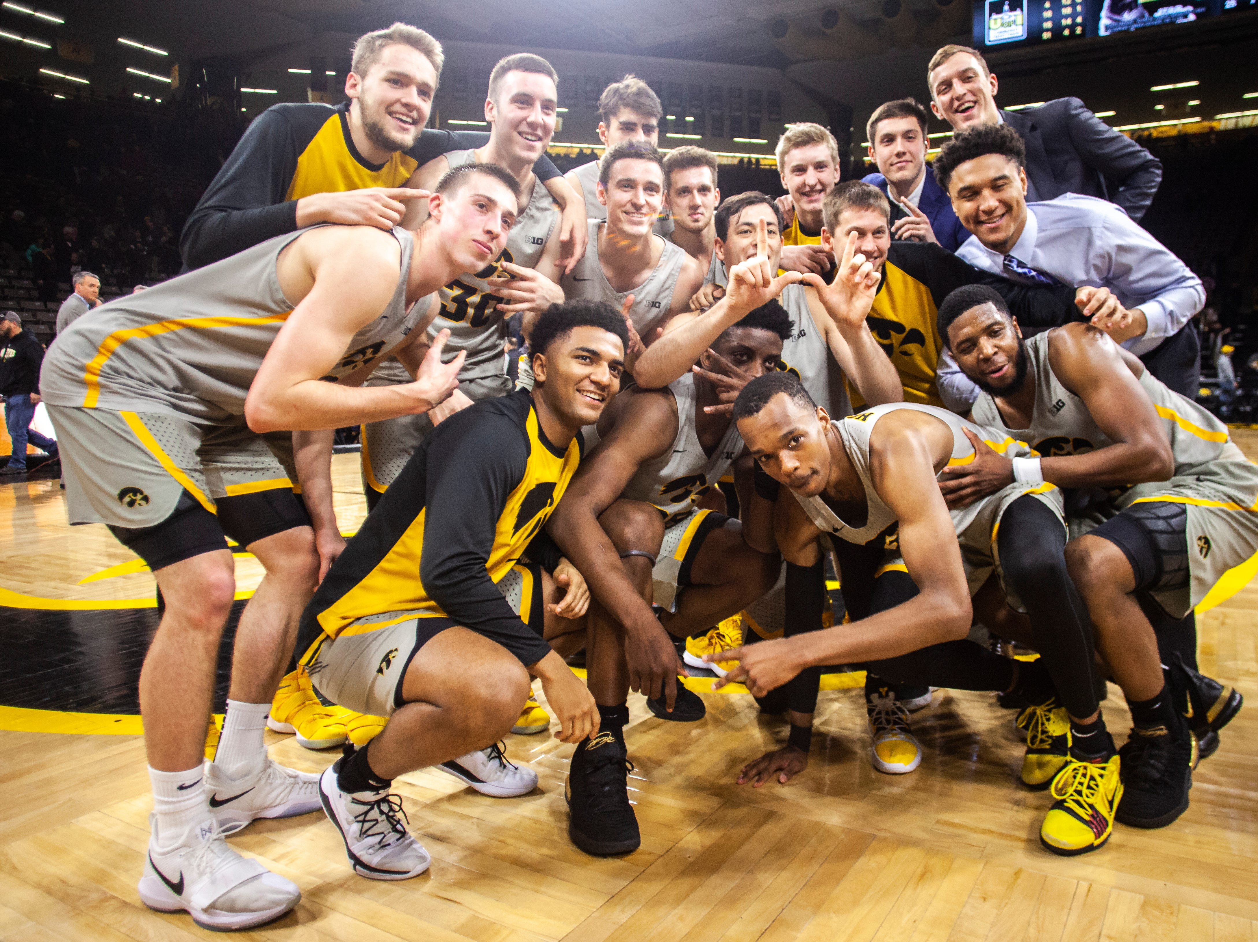 Iowa Hawkeyes players pose for a photo after a NCAA Big Ten Conference men's basketball game against Nebraska on Sunday, Jan. 6, 2019, at the Carver-Hawkeye Arena in Iowa City, Iowa. The Hawkeyes defeated, the Cornhuskers 93-84.