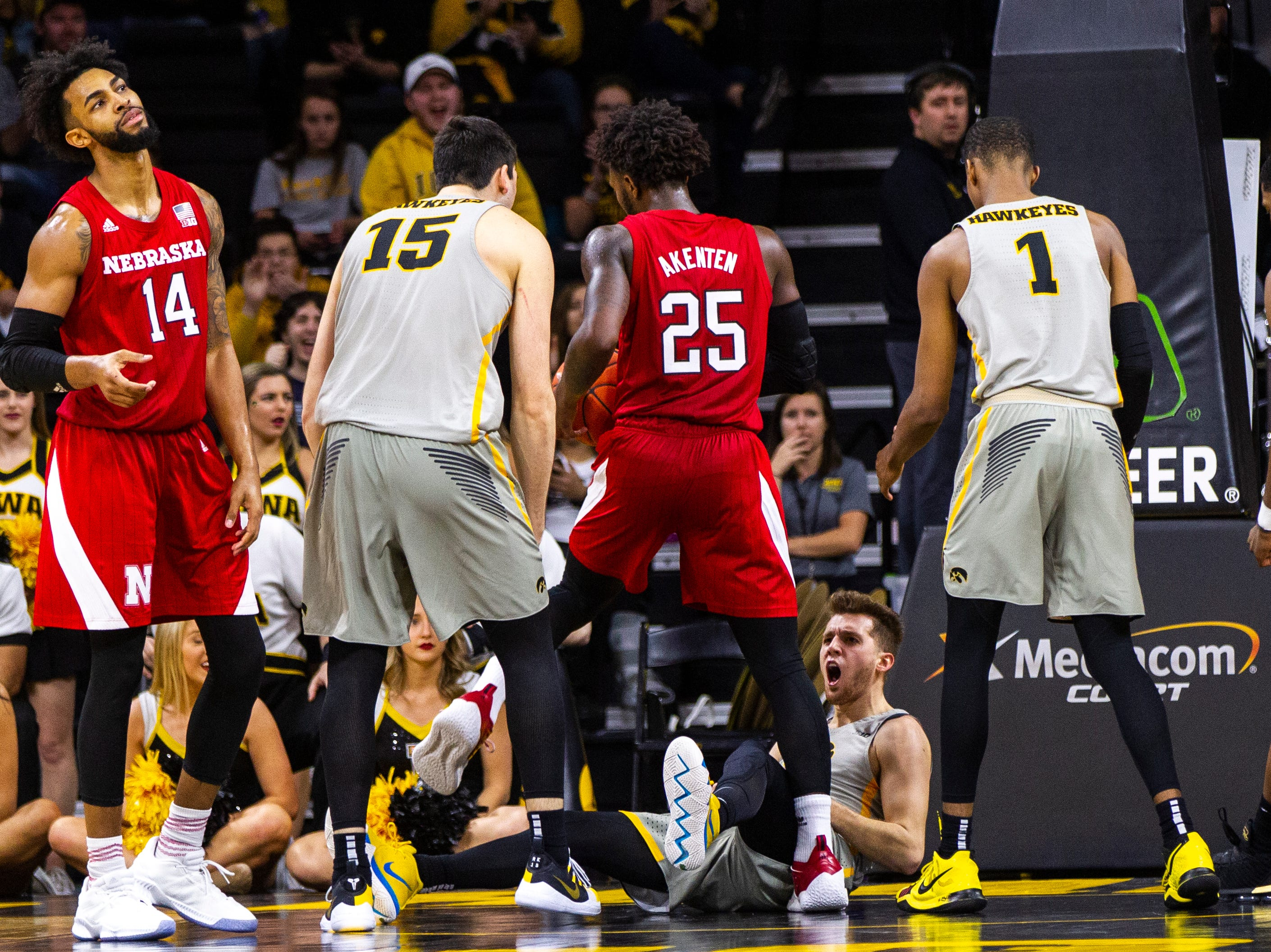 Iowa guard Jordan Bohannon (3) reacts after taking a charge while Nebraska forward Isaac Copeland Jr. (14) reacts during a NCAA Big Ten Conference men's basketball game on Sunday, Jan. 6, 2019, at the Carver-Hawkeye Arena in Iowa City, Iowa.