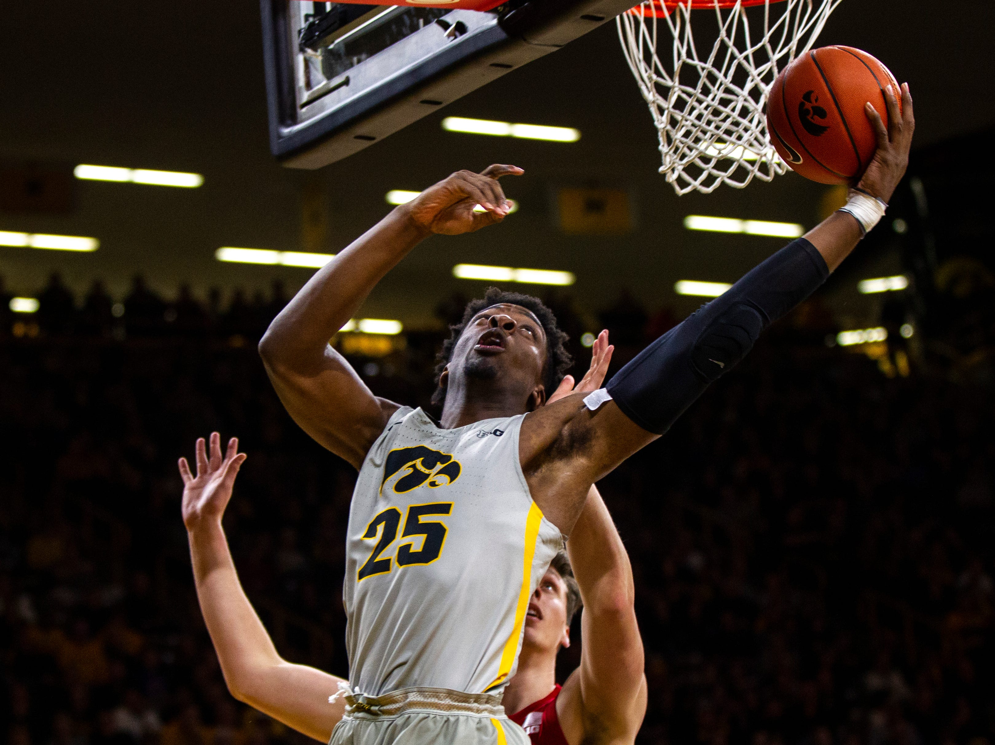 Iowa forward Tyler Cook (25) attempts a basket during a NCAA Big Ten Conference men's basketball game on Sunday, Jan. 6, 2019, at the Carver-Hawkeye Arena in Iowa City, Iowa.