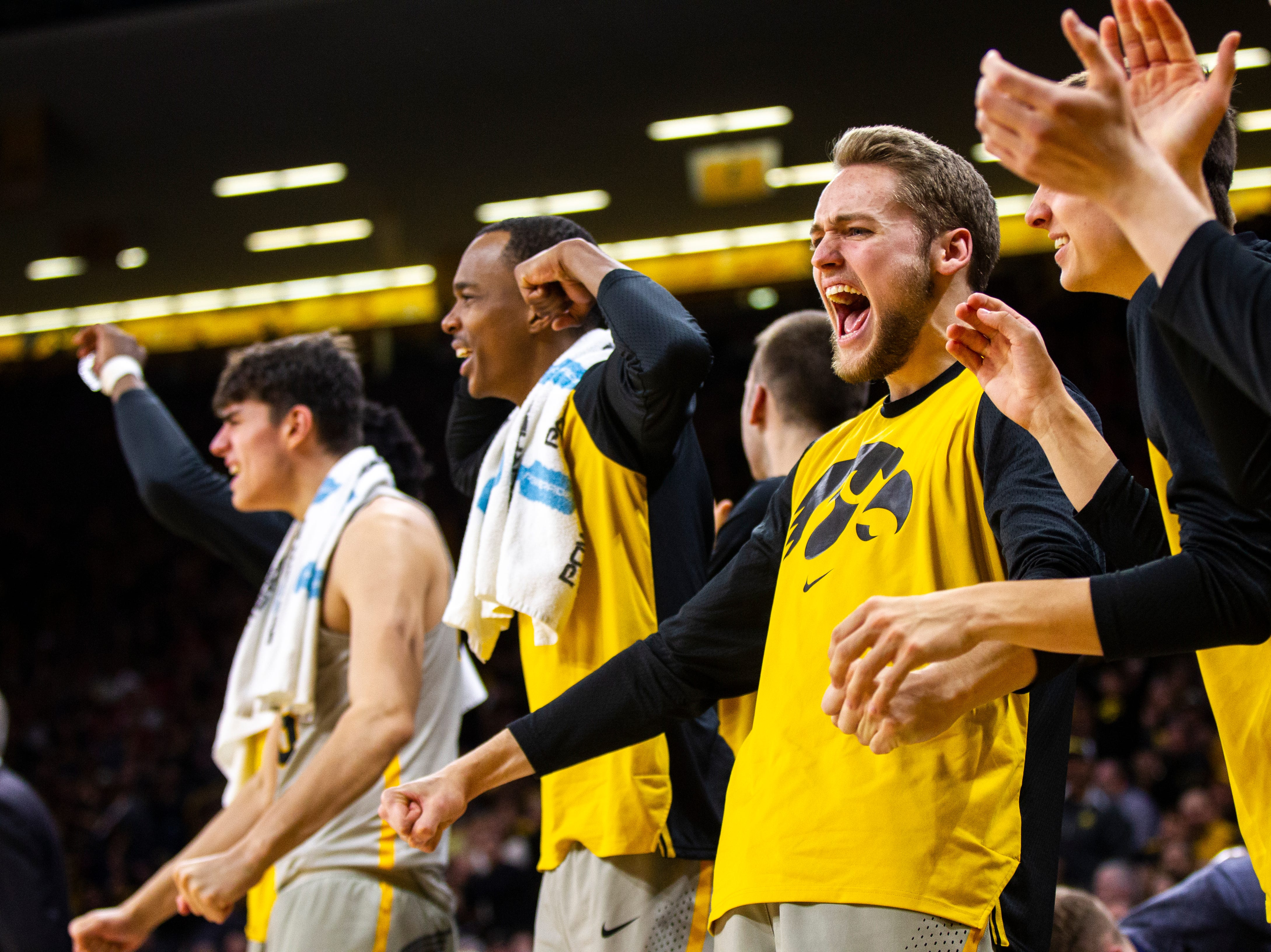Iowa's Riley Till and Maishe Dailey react on the bench during a NCAA Big Ten Conference men's basketball game on Sunday, Jan. 6, 2019, at the Carver-Hawkeye Arena in Iowa City, Iowa.