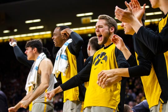 Riley Till, right, was promoted to scholarship status Wednesday. Iowa coach Fran McCaffery still has two open scholarships for the 2019-20 season.