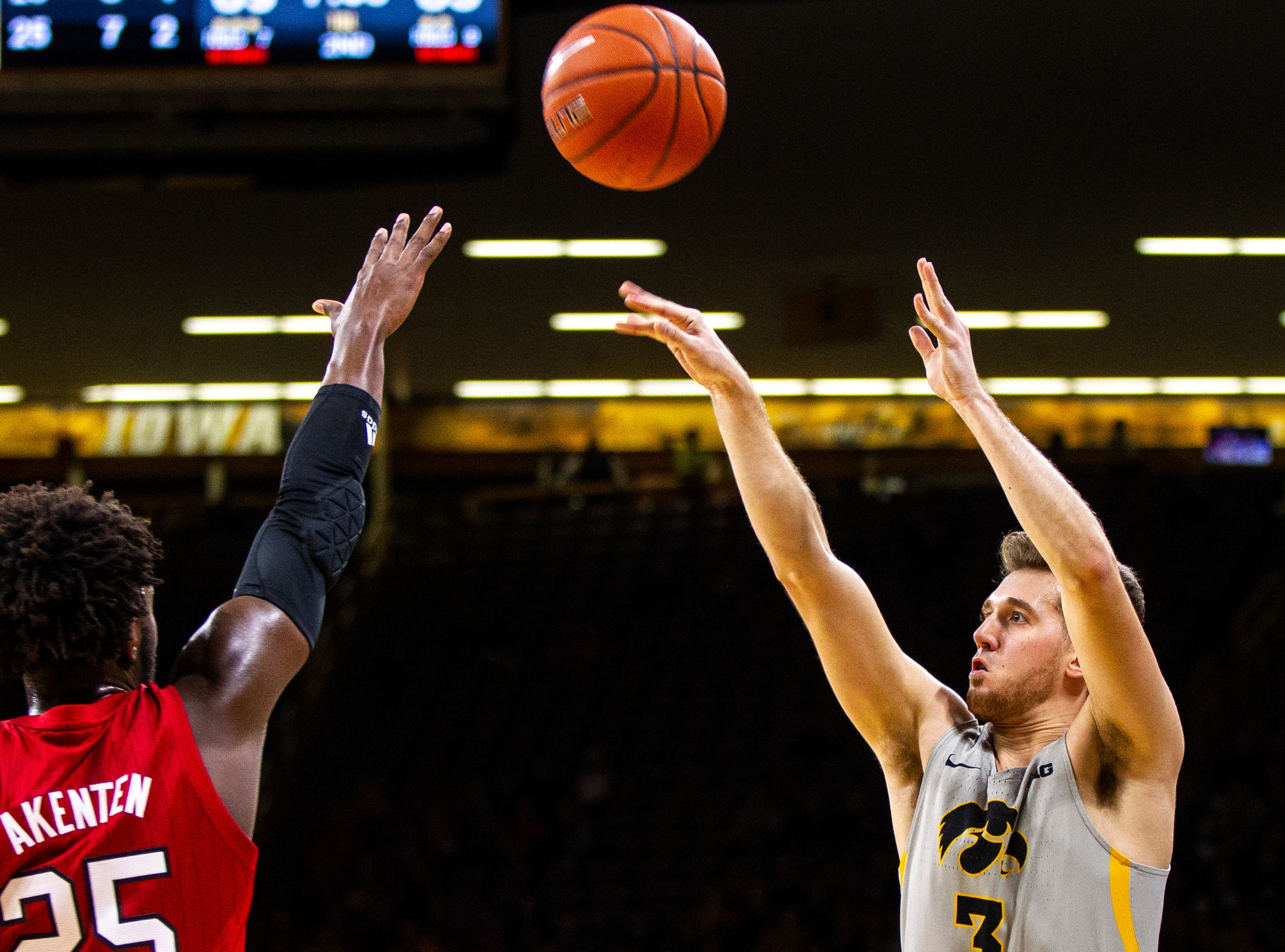 Iowa guard Jordan Bohannon (3) shoots a 3-point basket during a NCAA Big Ten Conference men's basketball game on Sunday, Jan. 6, 2019, at the Carver-Hawkeye Arena in Iowa City, Iowa.