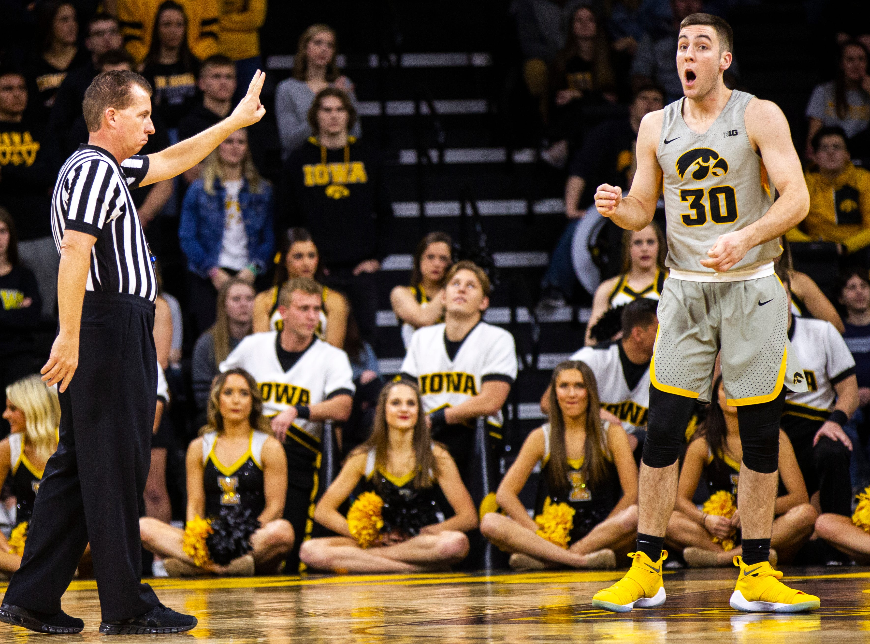 Iowa guard Connor McCaffery (30) reacts after being called four a foul during a NCAA Big Ten Conference men's basketball game on Sunday, Jan. 6, 2019, at the Carver-Hawkeye Arena in Iowa City, Iowa.