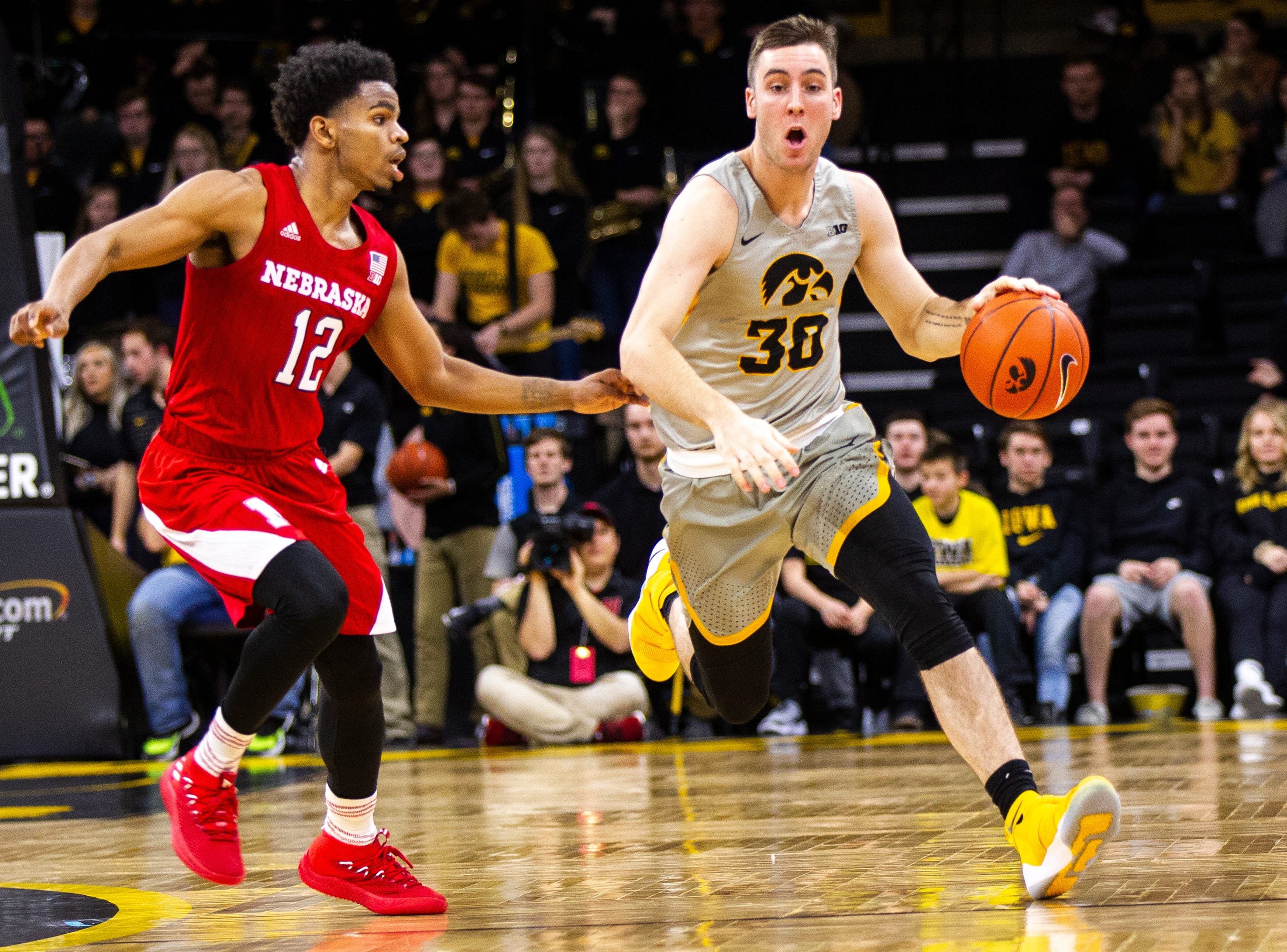 Iowa guard Connor McCaffery (30) takes the ball up court while being covered by Nebraska guard Thomas Allen (12) during a NCAA Big Ten Conference men's basketball game on Sunday, Jan. 6, 2019, at the Carver-Hawkeye Arena in Iowa City, Iowa.