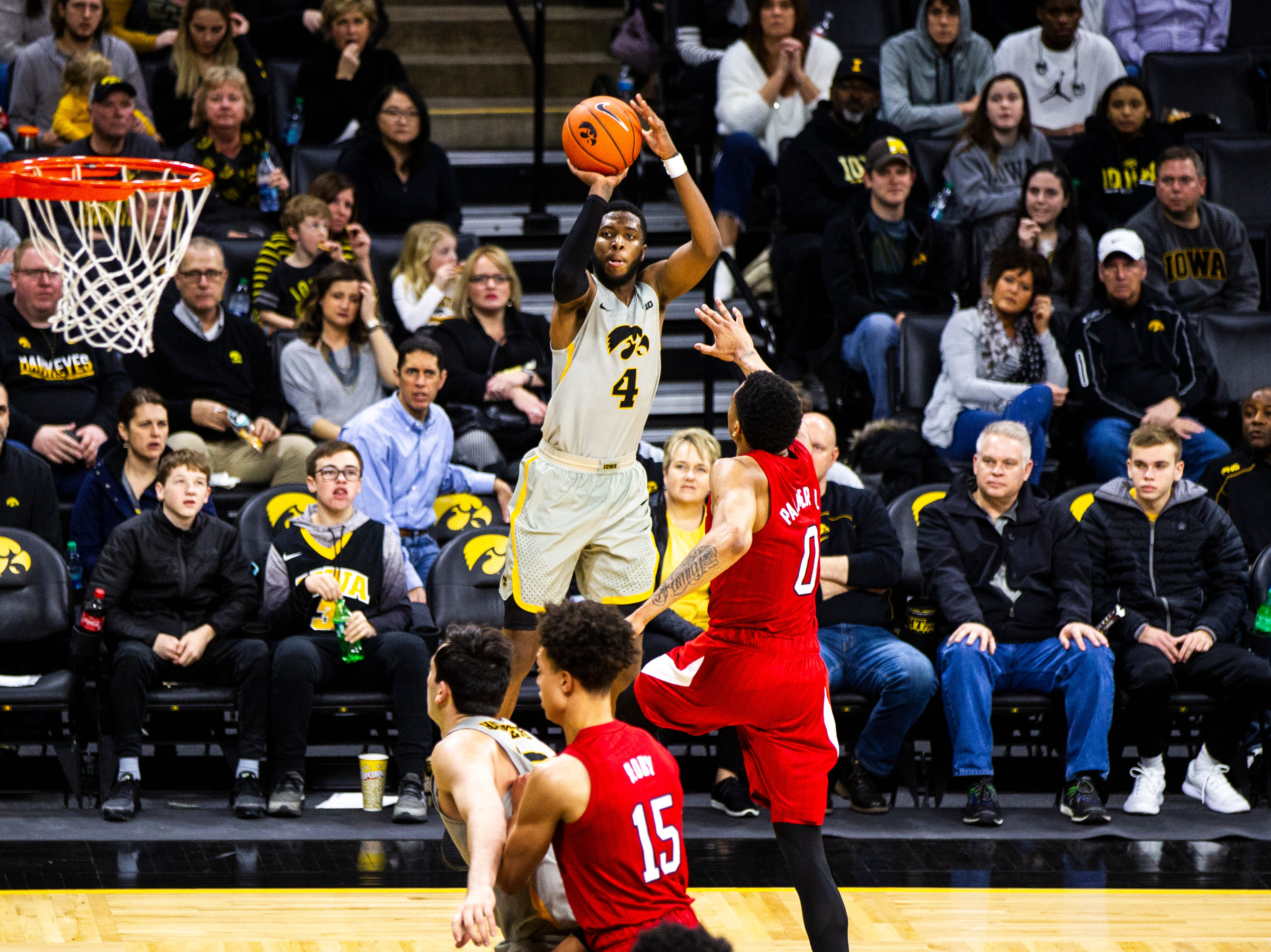 Iowa guard Isaiah Moss (4) shoots a 3-point basket during a NCAA Big Ten Conference men's basketball game on Sunday, Jan. 6, 2019, at the Carver-Hawkeye Arena in Iowa City, Iowa.