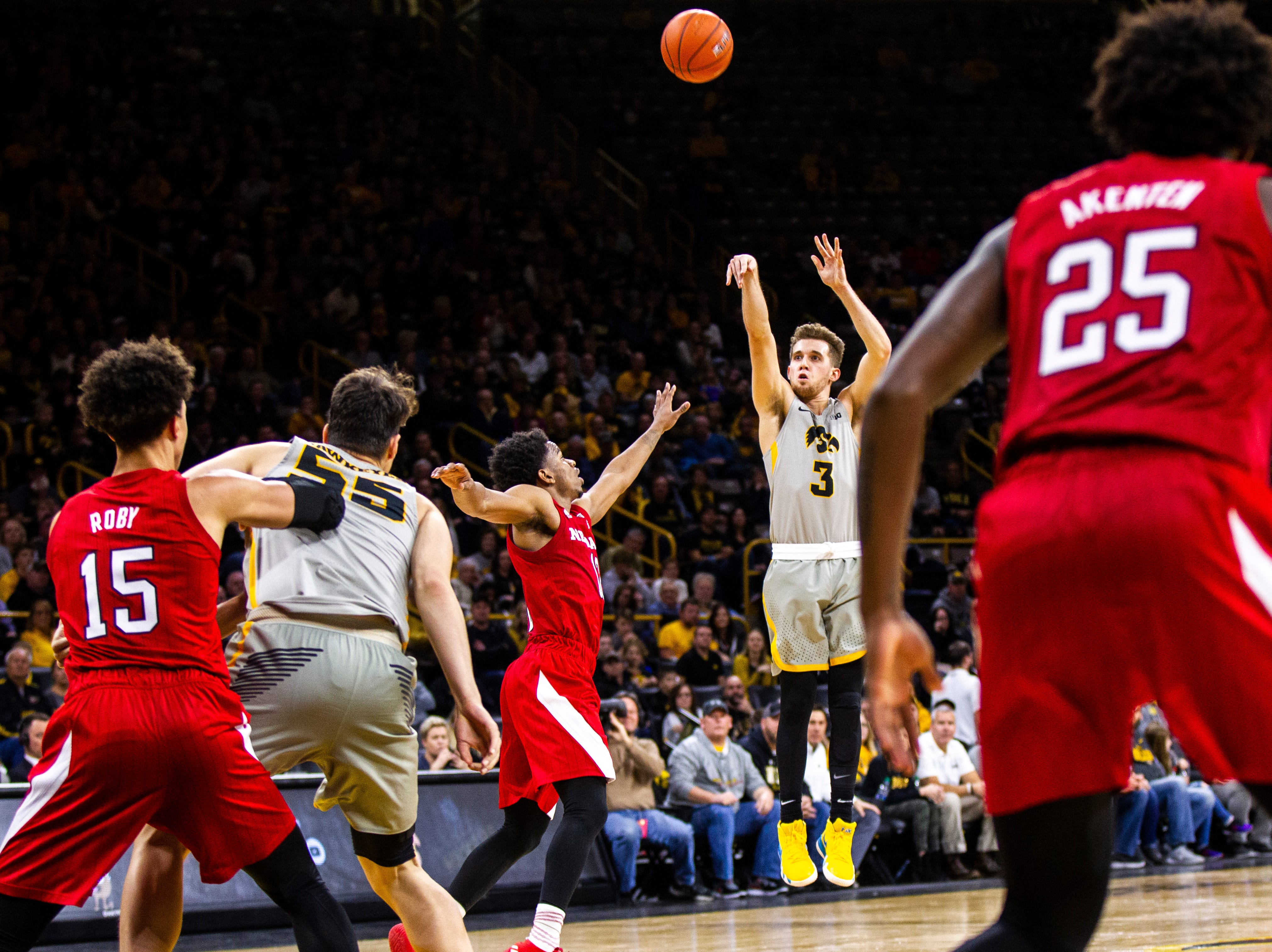 Iowa guard Jordan Bohannon (3) shoots a 3-point basket while being defended by Nebraska guard Thomas Allen (12) during a NCAA Big Ten Conference men's basketball game on Sunday, Jan. 6, 2019, at the Carver-Hawkeye Arena in Iowa City, Iowa.