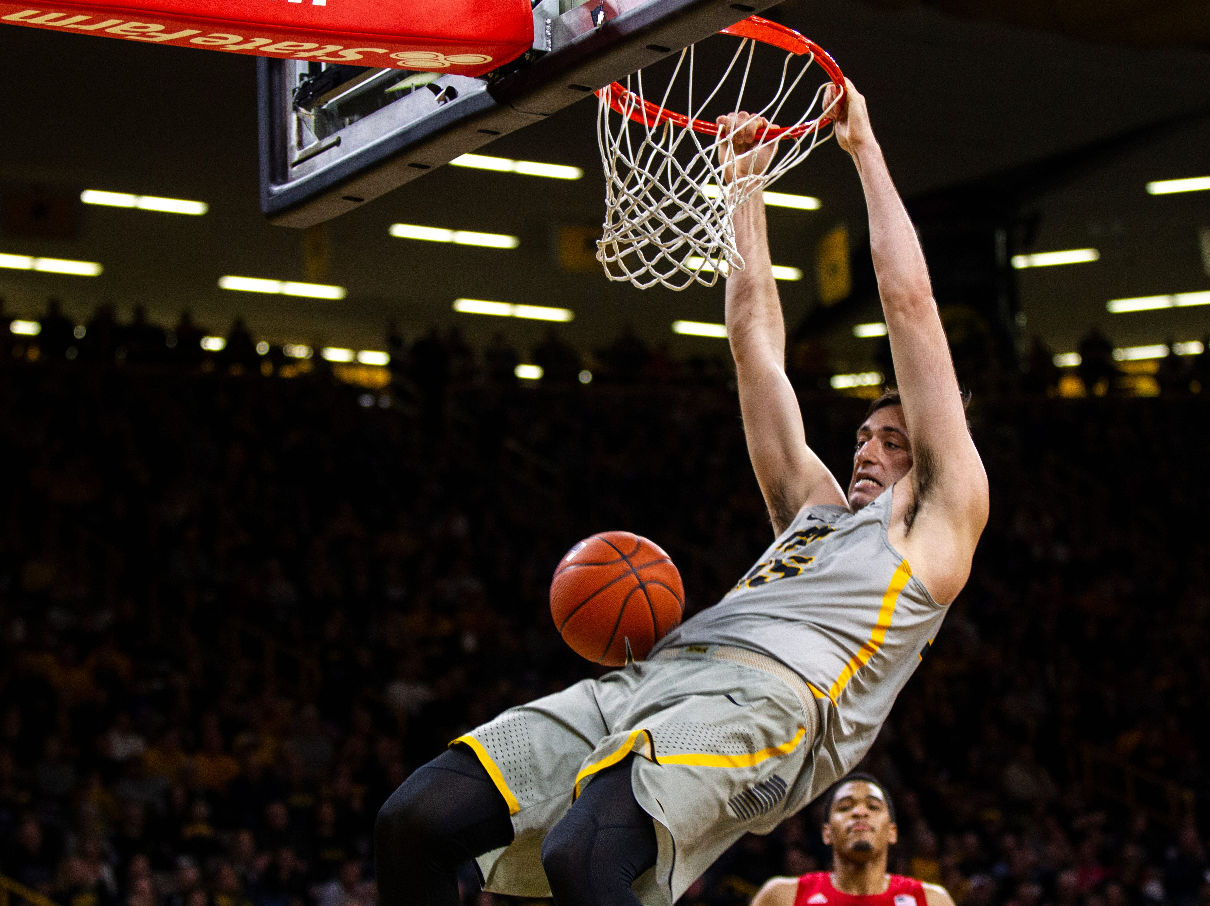 Iowa forward Ryan Kriener (15) dunks during a NCAA Big Ten Conference men's basketball game on Sunday, Jan. 6, 2019, at the Carver-Hawkeye Arena in Iowa City, Iowa.