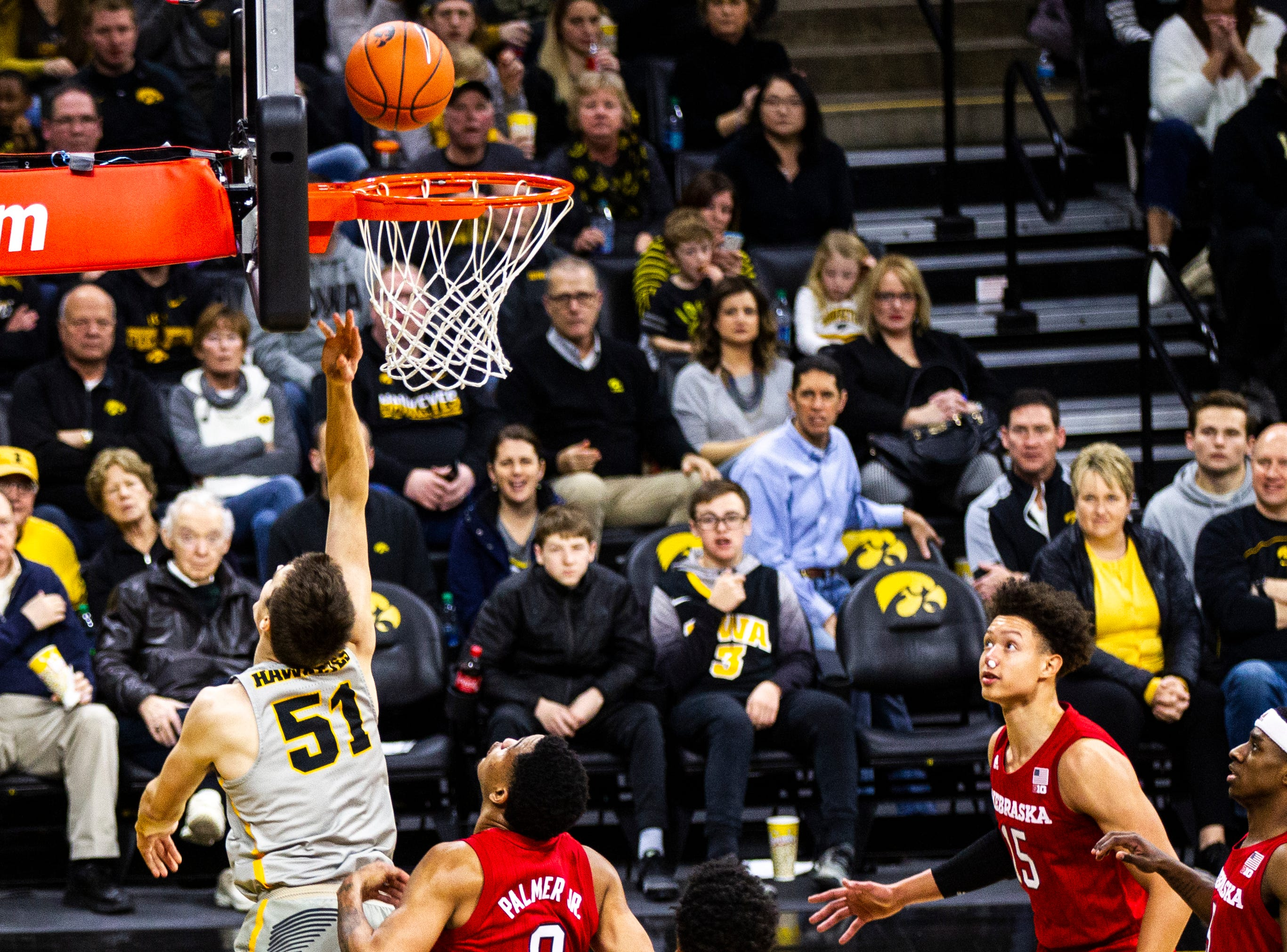 Iowa forward Nicholas Baer (51) attempts a basket during a NCAA Big Ten Conference men's basketball game on Sunday, Jan. 6, 2019, at the Carver-Hawkeye Arena in Iowa City, Iowa.