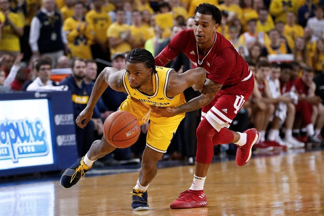 Michigan guard Zavier Simpson (3) is fouled by Indiana guard Devonte Green (11) in the second half of an NCAA college basketball game in Ann Arbor, Mich., Sunday, Jan. 6, 2019.