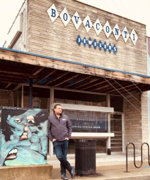 Georgia Street Grind owner Justin Jones in early 2019 stands in front of the future site of his Bovaconti Coffee shop, at the former Bovaconti Jewelers, 1042 Virginia Ave. in the Fountain Square area of Indianapolis.