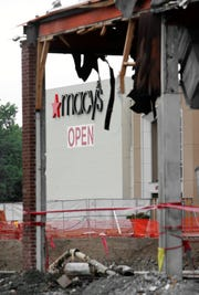 Macy's stands open in July 2007, while the old Glendale Mall is being torn down in the foreground to make way for the new Glendale Town Center which is expected to open by summer of 2008.