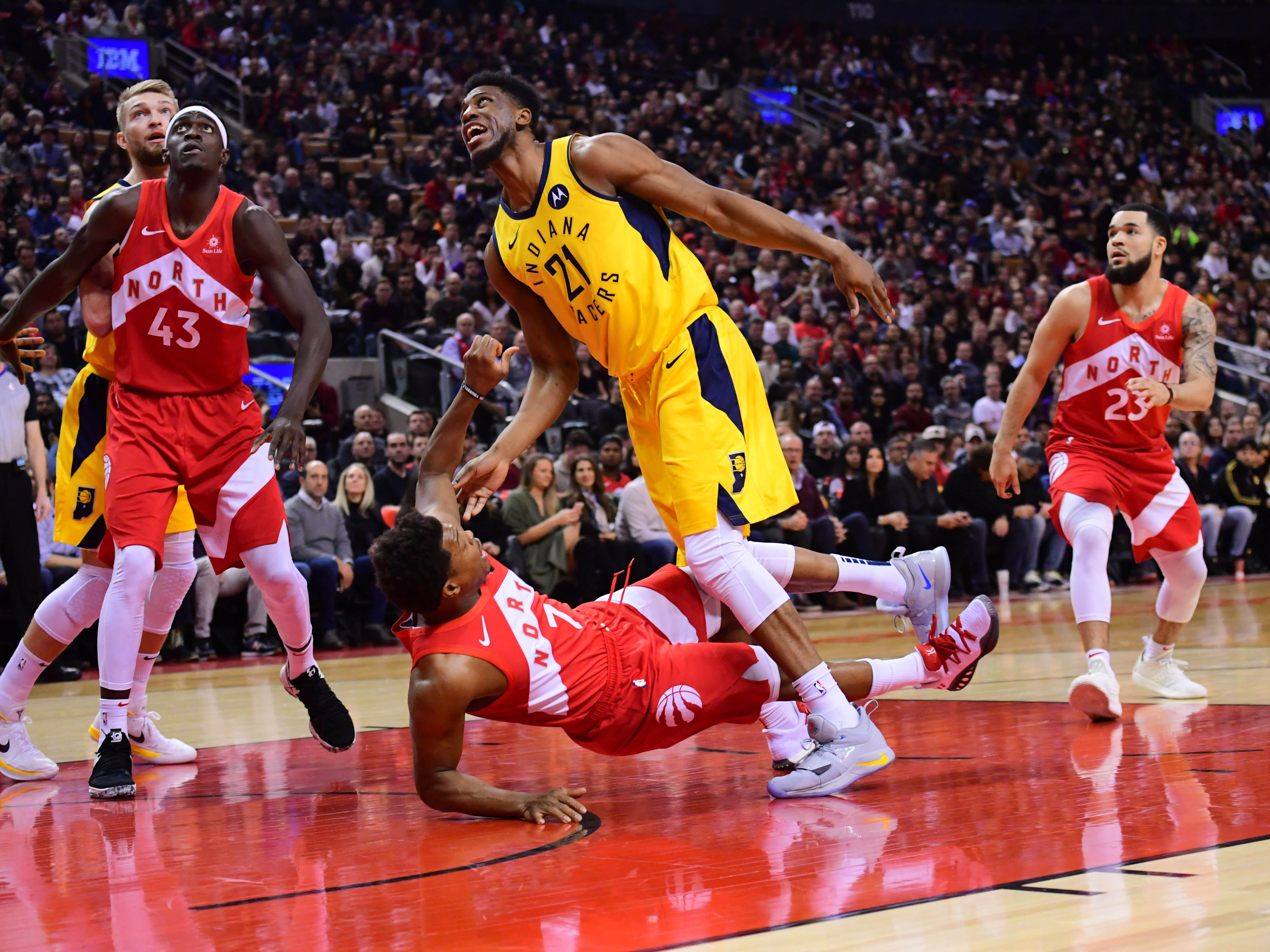 Jan 6, 2019; Toronto, Ontario, CAN; Indiana Pacers forward Thaddeus Young (21) battles with Toronto Raptors guard Kyle Lowry (7) during the first quarteragainst the Indiana Pacers at Scotiabank Arena.