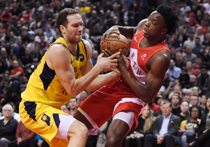Indiana Pacers forward Bojan Bogdanovic (44) and Toronto Raptors forward OG Anunoby (3) battle for the ball during first half NBA basketball action in Toronto on Sunday, Jan. 6, 2019.