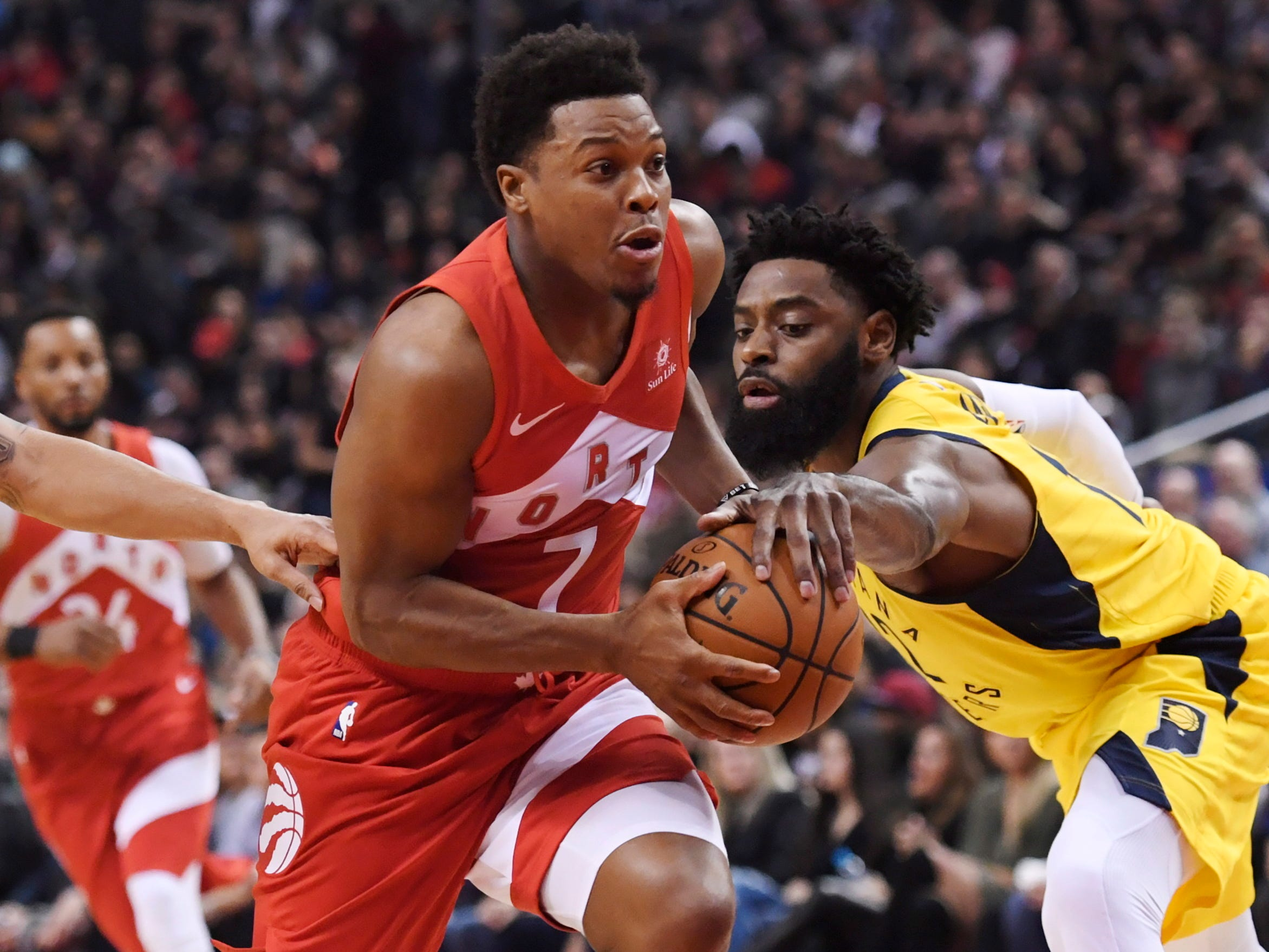 Toronto Raptors guard Kyle Lowry (7) drives past Indiana Pacers guard Tyreke Evans (12) during first half NBA basketball action in Toronto on Sunday, Jan. 6, 2019.
