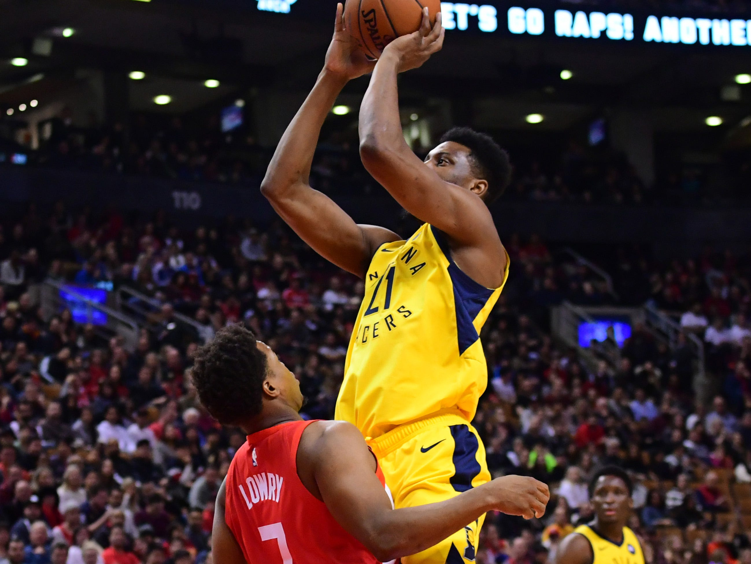 Jan 6, 2019; Toronto, Ontario, CAN; Indiana Pacers forward Thaddeus Young (21) takes a shot over Toronto Raptors guard Kyle Lowry (7) during the first quarteragainst the Indiana Pacers at Scotiabank Arena.