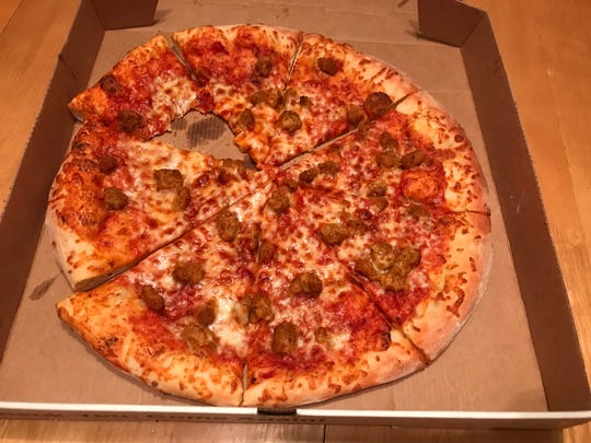 A pizza from $5 Pizza that was munched-on by the hungry arts, entertainment and dining reporter is shown on Jan. 5, 2019.